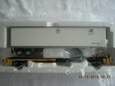7957 Burlington Northern front runner with 45' pines trailer