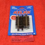 "6015 Atlas O scale 3 rail 1 1/4"" straight track"