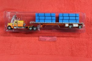 69-0700 DCP by First Gear 1:64th or S scale Kelsey's Trucking Peterbilt 359 tractor with flatbed trailer