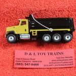 85514 Diecast Masters 1:87th scale Cat CT681 tri axle dump truck