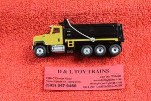 85514 Diecast Masters 1:87th scale Cat CT681 tri axle dump truck