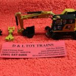 85656 Diecast Masters 1:87 or HO scale Cat M323F railroad wheeled excavator
