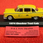 86601 Greenlight 1:43rd or O scale 1974 Checkers Taxi cab